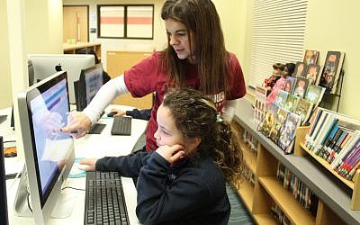 21st Century Learning Coordinator Stacy Brown works with student, Sierra Frank.
