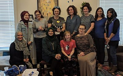 "Photo by Melisa Cahnmann-Taylor // Muslim and Jewish women of the ""Salaam-Shalom"" women's group, a new Athens chapter of the international organization, came together recently for a Chanukah party."