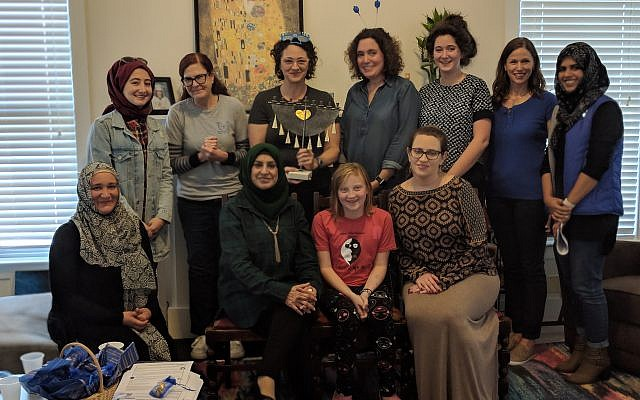 """Photo by Melisa Cahnmann-Taylor // Muslim and Jewish women of the """"Salaam-Shalom"""" women's group, a new Athens chapter of the international organization, came together recently for a Chanukah party."""