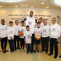 As part of his visit, Dikembe Mutombo gave away T-shirts to patients and fans.