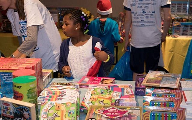 Children select gifts in the toy room.