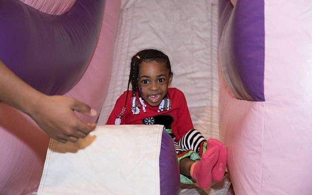 Photos by Eddie Samuels // Kids let loose on bouncy slides and castles.