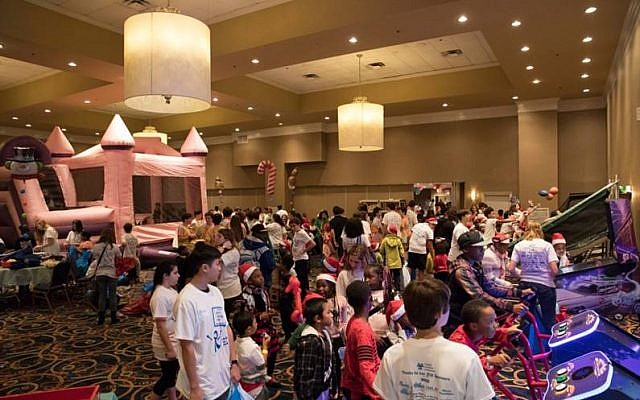 The carnival room is a hub of excitement for children to play games and participate in volunteer-led activities.