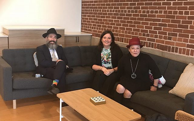 Rabbi Schusterman takes a moment to relax with volunteers Sandrine Simons and Denise Brody.