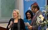 Ambassador Shorer sang Rock of Ages with Lavina and Nissim Reuben, assistant director of the Asia Pacific Institute.