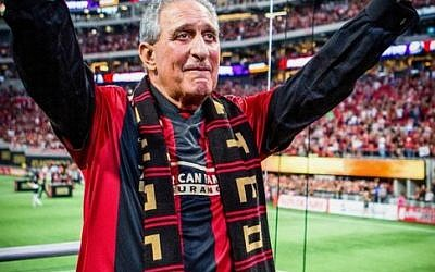 "Arthur Blank aka ""Uncle Arthur"" acknowledges the fans in Atlanta United's supporters section."