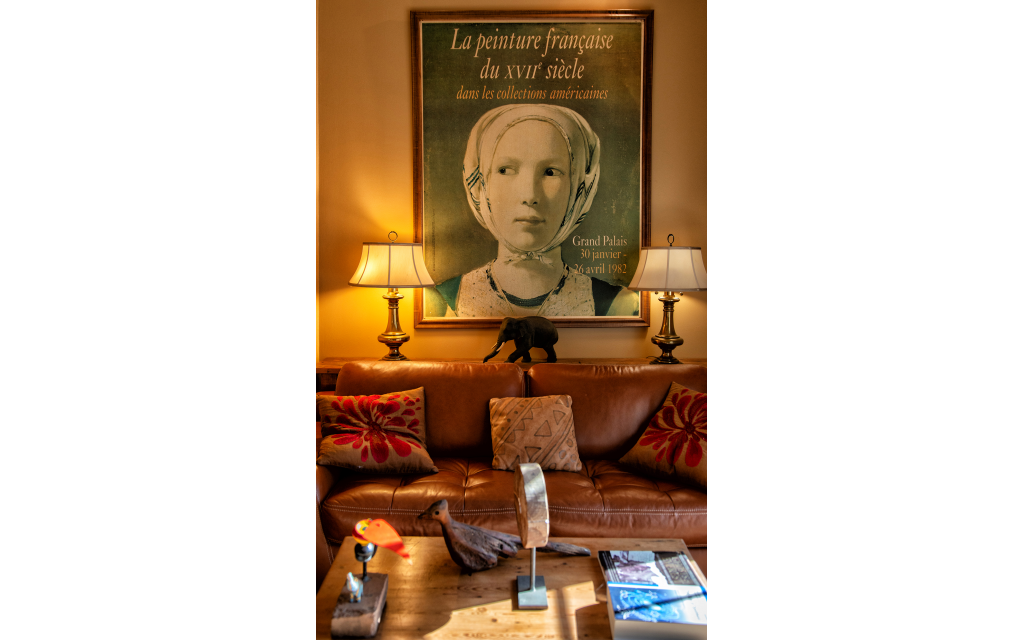 A Vermeer poster acquired in 1982 Musee d'Orsay, Paris is flanked by old brass lamps from Montreal, Canada 1960.