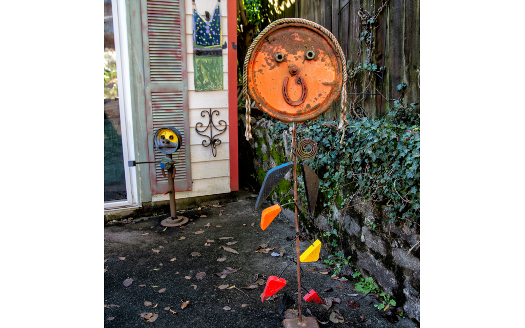 Padwa's recycled rust creatures pose in the driveway by his work studio.
