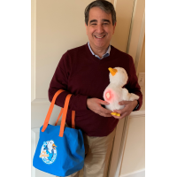Joey Moskowitz displays the aqua tote bag and duck whose stomach is glowing to show a happy mood.