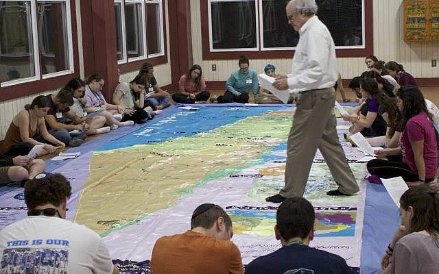 Photos courtesy of CIE // Center for Israel Education President Ken Stein uses a floor map of Israel to educate Jewish camp staffers about its geography during CIE's inaugural three-day seminar at Camp Ramah Darom in Clayton, Georgia.