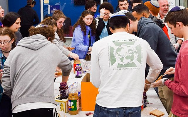 AJA students prepare lunches for those in need.