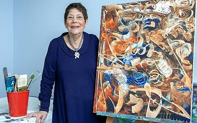 "Photos by Duane Stork // Barbara Wilensky shows off her work ""Morning Haze."" Her artwork is displayed at I.D.E.A. Gallery in Chamblee, owned by Amy Spanier."
