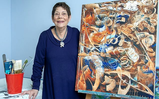 """Photos by Duane Stork // Barbara Wilensky shows off her work """"Morning Haze."""" Her artwork is displayed at I.D.E.A. Gallery in Chamblee, owned by Amy Spanier."""