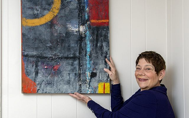 """Wilensky displays her favorite piece of her own work: """"Abstract in Crimson and Gray"""" acrylic with cement for texture,  and  oil stick."""