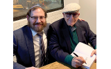 Guest speaker Myron Sugerman enthralled a packed Intown Chabad audience, seen here with Rabbi Ari Sollish, signing his book.
