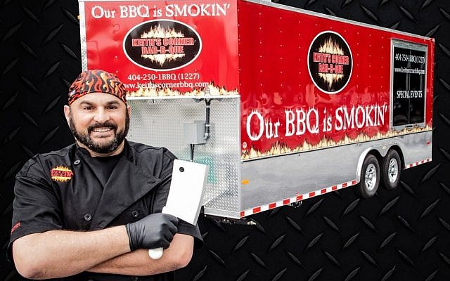 Pit master Keith Marks poses with his trailer.
