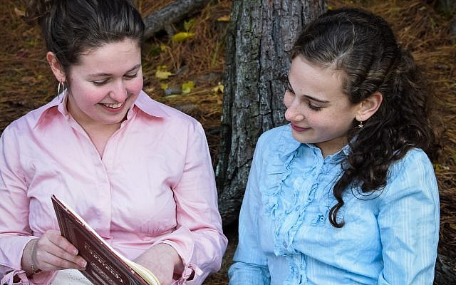 """Chloe Karpel, 11th grade, and Leah Houben, ninth grade, act in a scene from the play, """"Raizel's Riddle."""""""