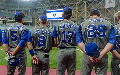 Team Israel sports kippot under baseball caps.