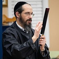 Photos by Eddie Samuels // Rabbi Amitai ben David expertly demonstrates how he checks the edge of his blade using the flesh of his finger without cutting himself.