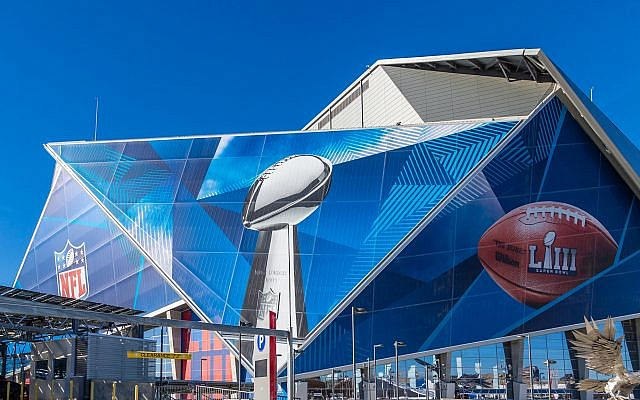 Clad in Super Bowl graphics, Atlanta's Mercedes Benz-Stadium will host the Los Angeles Rams and New England Patriots.