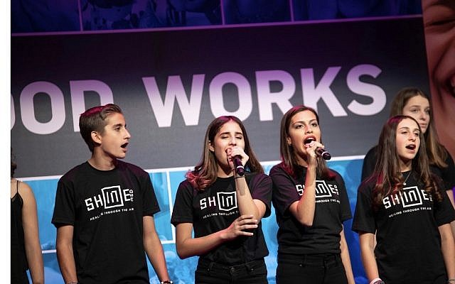 """MSD students Michael Catapano, Arianna Otero, Maria Lugo, and Iliana Waitze Zuckerman perform the student-composed """"Shine,"""" written to channel the frustration many students felt after the shooting."""