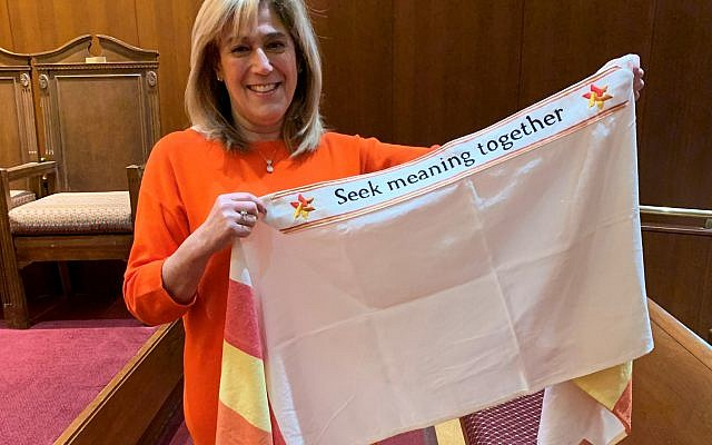Margo Gold cherishes her outgoing gift tallit expressing gratitude for her years of service.