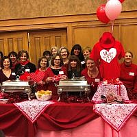 The auxiliary volunteers spread love and upbeat wishes for Valentine's Day. Sherry Jaffe Habif, left of the heart T-shirt, decorated the room.