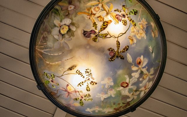 The detailed light fixture in the entrance by Connie Sweet was commissioned by Cory.