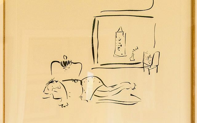"The couple enjoy this original John Lennon sketch,""John and Yoko 1977."""