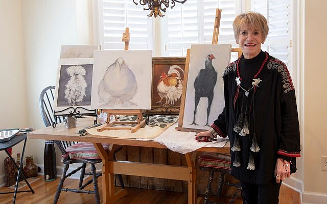 """Photos by Heidi Morton // Sheila Holtz's art studio is her """"chicken coop."""" She has mastered the feather details and shadows. Gallery owner Amy Spanier states that she sells Sheila's chicken paintings as fast as she can produce them."""