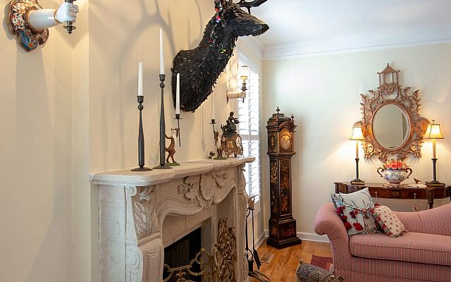 The mirror is Italian wood. The Chinoiserie clock is black hand-painted enamel.