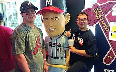 Jack Prettyman and Philip Flores at an Atlanta Braves baseball game.