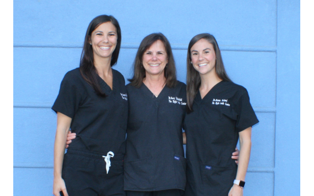 Dr. Novy Scheinfeld (center) practices dentistry with her daughters, Dr. Zoey Scheinfeld (left) and Dr. Hanna Scheinfeld Orland (right).