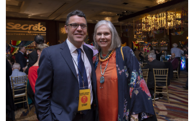 Photos courtesy of Heidi Morton // Gala Chair Martha Jo Katz admires the color-laden room and throng of patrons. Pictured here with Kenny Blank, AJFF executive director.