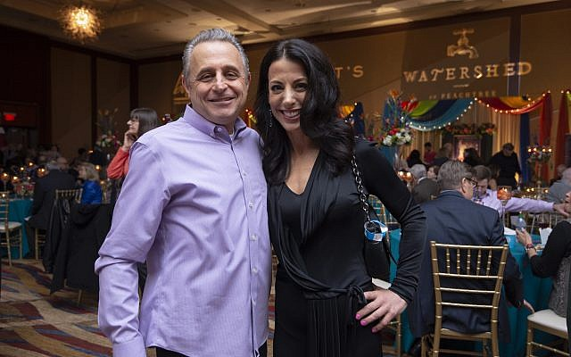 Fuego Mundo owner Udi Hershkovitz poses with Hannah Whitlock in black Balenciaga in front of the Watershed table.