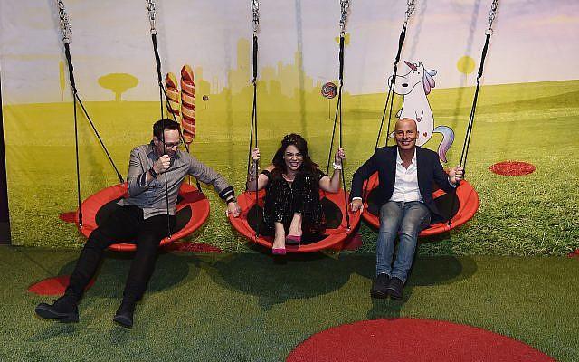 Candytopia team, Zac Hartog, Jackie Sorkin and John Goodman enjoy the swinging pods.