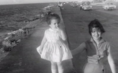 Young Behar, in her holiday best, with her mother on an oceanfront boulevard in Havana.