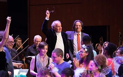 "Reiman takes a bow at the Atlanta Symphony Orchestra with composer Robert Elhai after a performance of ""Jump: A Cultural Symphony."""