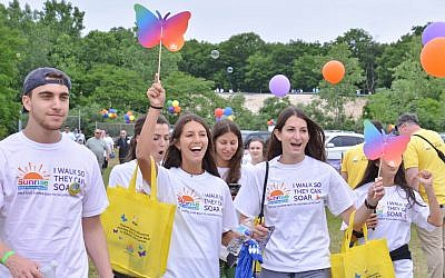 Walk participants celebrate at the finish line of SunriseWALKS Long Island.