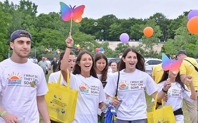 Walk participants celebrate at the finish line of SunriseWALKS Long Island.