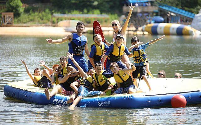 Campers and staff enjoy aquatics on the lake at Camp Barney Medintz.