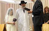 Kathleen and Paul Gray's wedding at the Sandy Springs Kehilla Jan. 2 with Rabbi Karmi David Ingber.