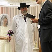 Kathleen and Paul Gray's wedding at the Sandy Springs Kehilla Jan. 2 with Rabbi Karmi David Ingber.