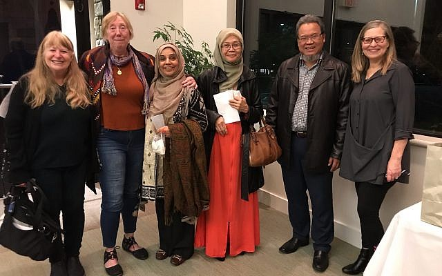 The interfaith community came together to hear author-activist Mohammed Al Samawi at Temple Beth Tikvah. Pictured here are members of the Emerson Unitarian Universalist Congregation, East Cobb Islamic Center and Rabbi Alexandria Shuval-Weiner (right).