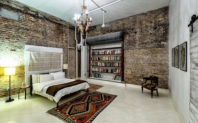 "Master bedroom: Julia calls the loft ""a hidden gem."" She loves the openness of 20-foot ceilings and 2,076 square feet of living space, quite unusual for an older building loft."