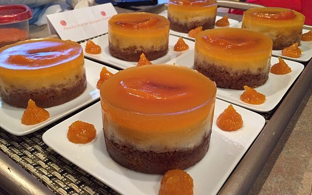 Sandi's mirror glazed cheesecakes won first place for Best Peach Dessert at the three largest barbecue contests in Atlanta. Biscoff cookie crust filled with amaretto peach cheesecake and topped with a mango peach mirror glaze.