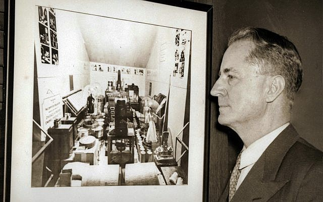 "Oglethorpe University President Thornwell Jacobs, the ""father of the modern time capsule,"" looking at a picture of the Crypt of Civilization's contents before its door was welded shut."