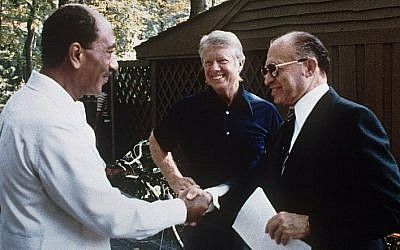 Israeli Prime Minister Menachem Begin, right, Egyptian President Anwar Sadat, left, and President Jimmy Carter at Camp David in September 1978.