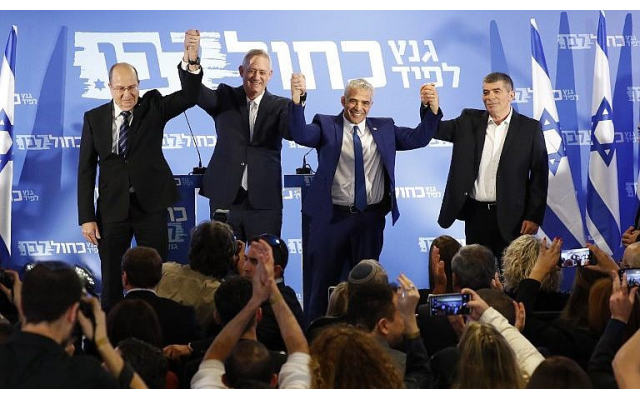 From left: Blue and White party leaders Moshe Ya'alon, Benny Gantz, Yair Lapid and Gabi Ashkenazi pose for a picture after announcing their electoral alliance in Tel Aviv on February 21, 2019. (Jack Guez/AFP)