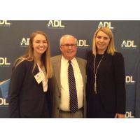 Bennet Alsher, ADL board member and Ford Harrison attorney, with Courtney Majors, left, and Chelsey Lewis, right.